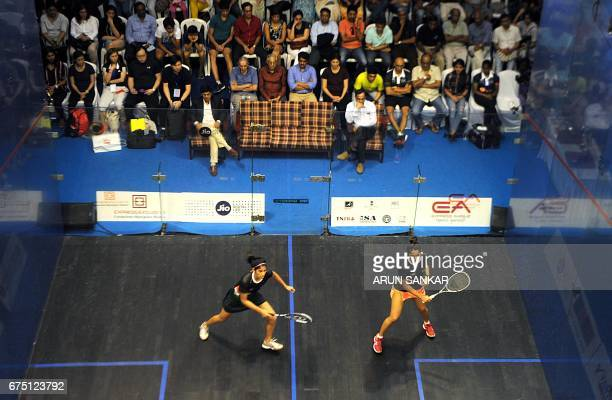 India's Joshana Chinnappa plays a shot against her compatriot Dipika Pallikal during their women's final match at the 19th Asian Squash Championship...