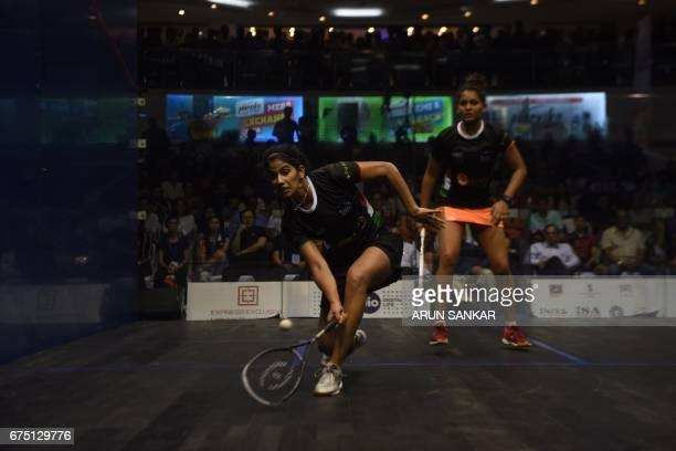 India's Joshana Chinnappa plays a shot against her compatriot Dipika Pallikal during the women's final match at the 19th Asian Squash Championship in...