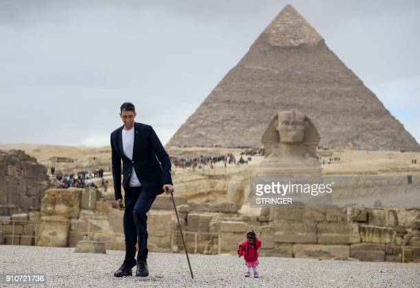 India's Jyoti Amge the world's shortest woman poses for a picture with Sultan Kosen of Turkey the world's tallest man at the site of the Pyramids of...