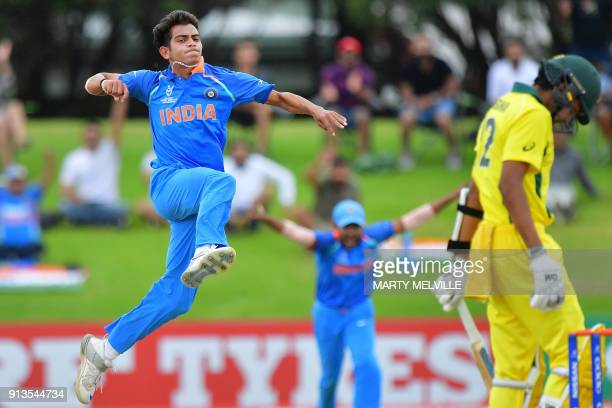 India's Kamlesh Nagarkoti celebrates Australia's captain Jason Sangha being caught during the U19 World Cup cricket final match between India and...