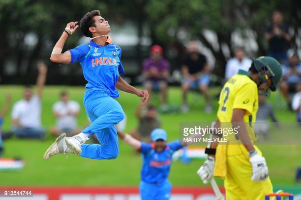 TOPSHOT India's Kamlesh Nagarkoti celebrates Australia's captain Jason Sangha being caught during the U19 World Cup cricket final match between India...