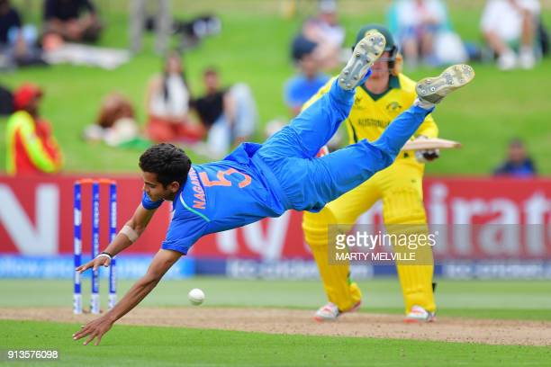 India's Kamlesh Nagarkoti dives as he attempts to catch out Australia's Lloyd Pope during the U19 World Cup cricket final match between India and...