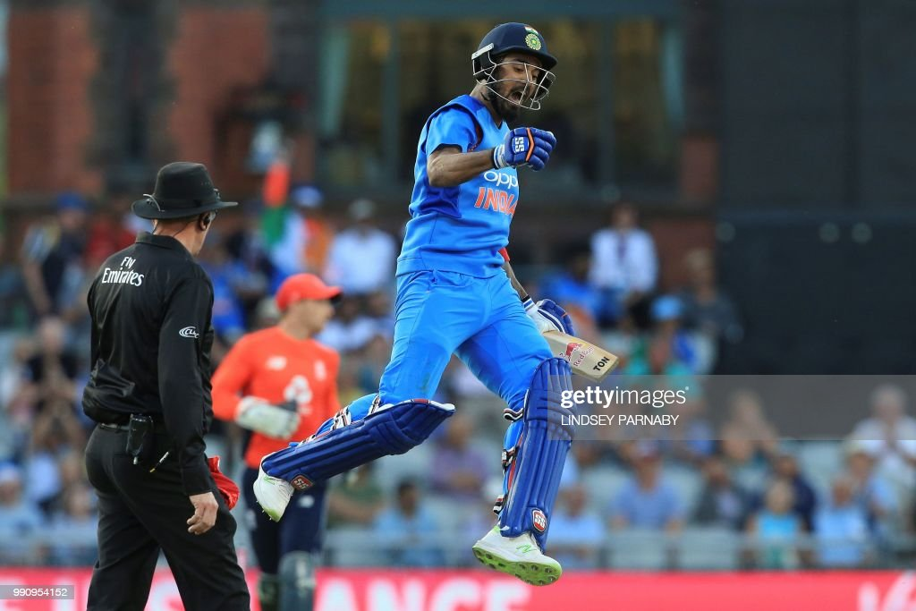 India's Kannanur Lokesh Rahul celebrates scoring his century during the international Twenty20 cricket match between England and India at Old Trafford cricket ground in Manchester, northwest England, on July 3, 2018. (Photo by Lindsey PARNABY / AFP) / RESTRICTED