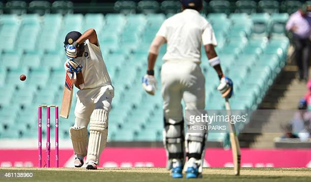 India's Karn Sharma bats as partner Lokesh Rahul looks on during day three of the fourth cricket Test between Australia and India at the Sydney...