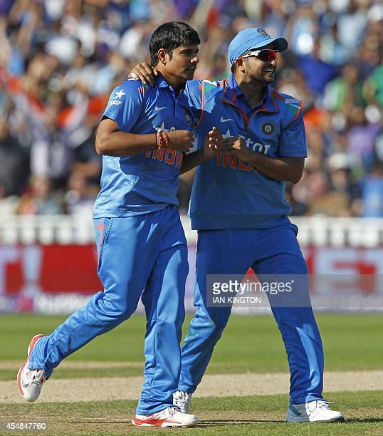 Indias Karn Sharma celebrates taking the wicket of Englands Joe Root for 26 runs during the T20 international cricket match between England and India...