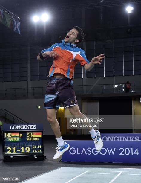 India's Kashyap Parupalli celebrates beating Singapore's Derek Wong in the men's singles badminton gold medal final match at the Emirates Arena...