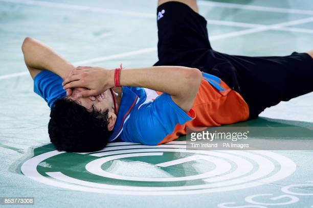 India's Kashyap Parupalli reacts after beating England's Rajiv Ouseph during his singles Bronze medal match against at the Emirates Arena during the...