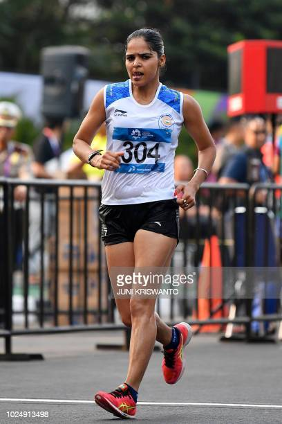 India's Kaur Khusbir competes in the women's 20km walk race competition during the 2018 Asian Games in Jakarta on August 29 2018