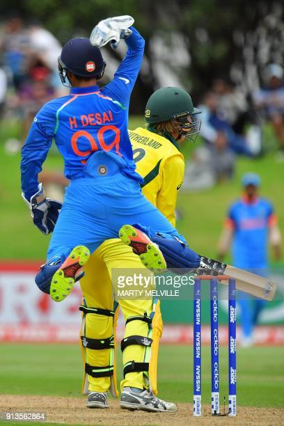 India's keeper Harvik Desai celebrates catching Australia's Will Sutherland during the U19 World Cup cricket final match between India and Australia...