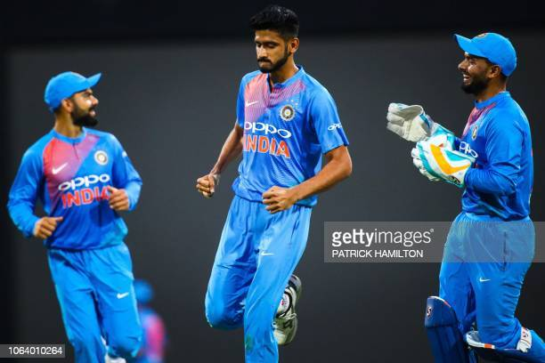India's Khaleel Ahmed celebrates after dismissing Australia's batsman D'Arcy Short during the T20 international cricket match between Australia and...