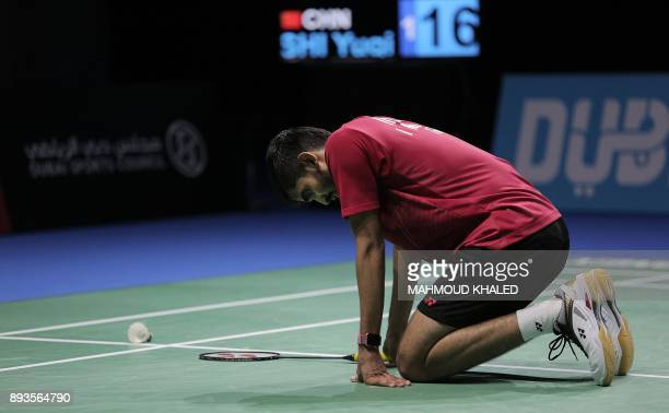 India's Kidambi Srikanth rests after falling down while trying to return a shot to China's Shi Yuqi during the third day of the Dubai Badminton World...