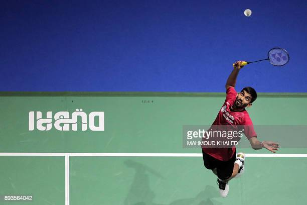 India's Kidambi Srikanth returns a shot to China's Shi Yuqi during the third day of the Dubai Badminton World Superseries Finals in Dubai on December...