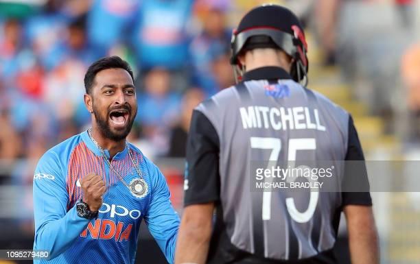 India's Krunal Pandya celebrates the wicket of New Zealand's Daryl Mitchell during the second Twenty20 international cricket match between New...