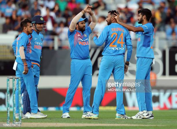 India's Krunal Pandya celebrates the wicket of New Zealand's Kane Williamson during the second Twenty20 international cricket match between New...