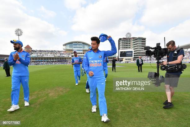 India's Kuldeep Yadav acknowledges the applause of the crowd as he leaves the field after the England Innings taking six wickets during the One Day...