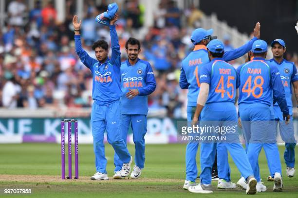 India's Kuldeep Yadav celebrates after finishing his spell taking his sixth wicket that of England's David Willey during the One Day International...