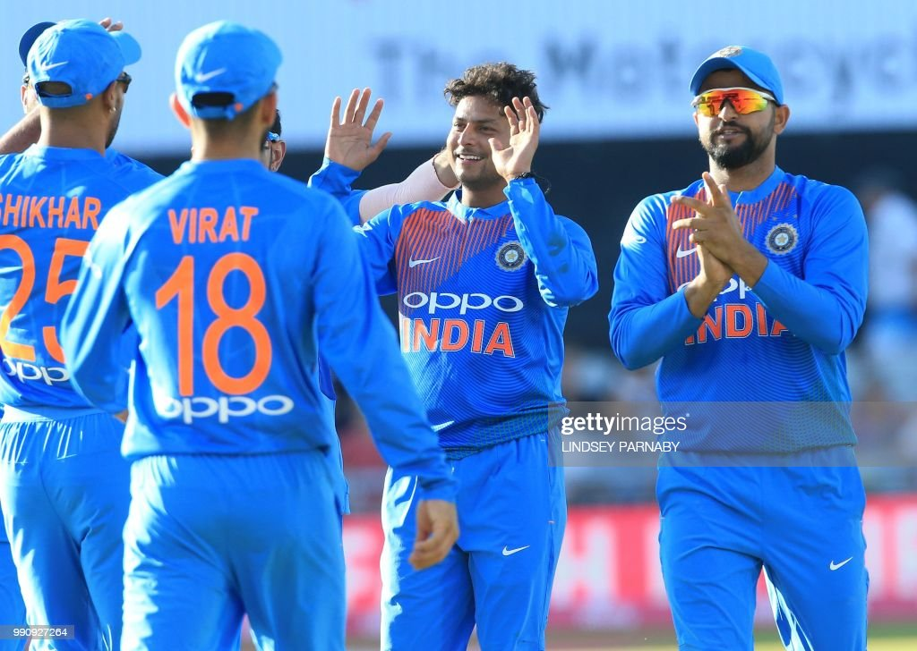 India's Kuldeep Yadav (C) celebrates after taking the wicket of England's Jos Buttler during the international Twenty20 cricket match between England and India at Old Trafford cricket ground in Manchester, northwest England, on July 3, 2018. (Photo by Lindsey PARNABY / AFP) / RESTRICTED