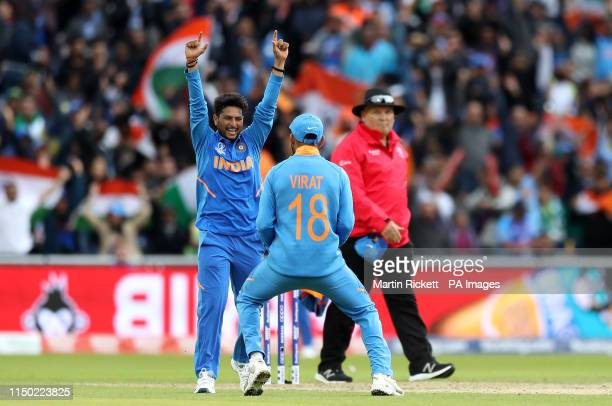 India's Kuldeep Yadav celebrates taking the wicket of Pakistan's Fakhar Zaman during the ICC Cricket World Cup group stage match at Emirates Old...