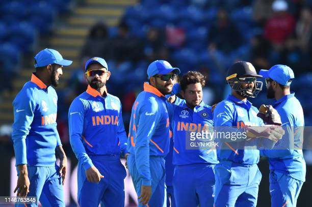 India's Kuldeep Yadav celebrates with teammates after taking the wicket of Bangladesh's Mushfiqur Rahim for 90 during the 2019 Cricket World Cup warm...