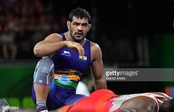 India's Kumar Sushil reacts as he wins against Canada's Jevon Balfour during the men's freestyle 74 kg wrestling match at the 2018 Gold Coast...