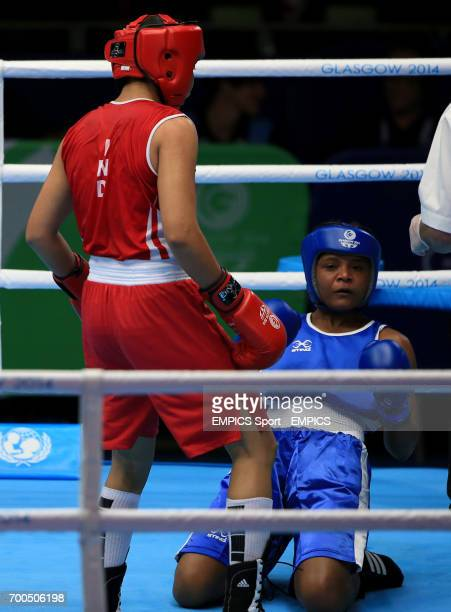 India's Laishram Devi in action against Mozambique's Maria Machongua in the Women's Light Semifinal 2 at the SECC during the 2014 Commonwealth Games...