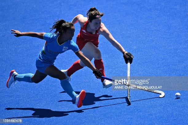 India's Lalremsiami and Britain's Laura Unsworth vie for the ball during the women's bronze medal match of the Tokyo 2020 Olympic Games field hockey...