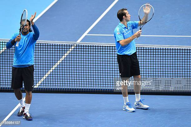 India's Leander Paes and his partner Czech Republic's Radek Stepanek celebrate their victory over US tennis player Bob Bryan and US tennis player...