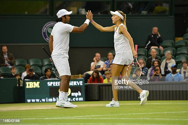 India's Leander Paes and Russia's Elena Vesnina slap hands during their mixed doubles final defeat to US player Mike Bryan and US player Lisa Raymond...