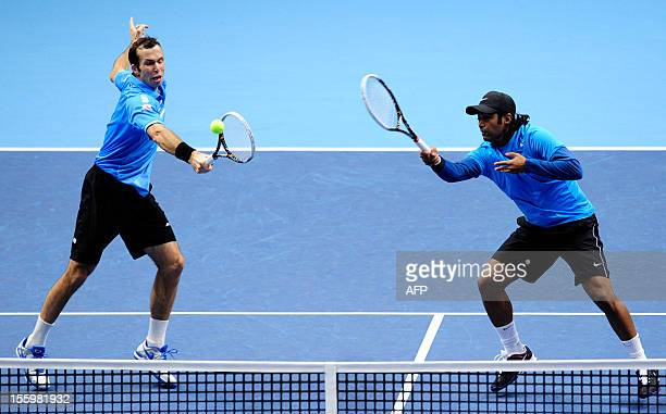 India's Leander Paes watches as his partner Czech Republic's Radek Stepanek returns against US tennis player Bob Bryan and US tennis player Mike...