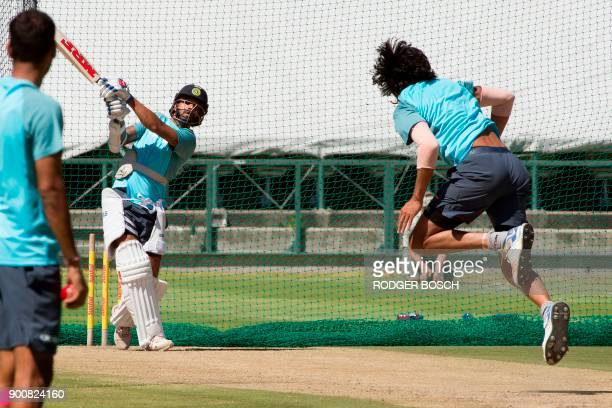 India's lefthanded opening batsman and occasional rightarm off bowler Shikhar Dhawan hits a ball of India's bowler Ishant Sharma as they take part in...