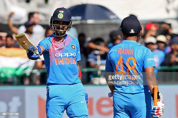 India's Lokesh Rahul celebrates reaching his half century during the Twenty20 International cricket match between Ireland and India at Malahide...