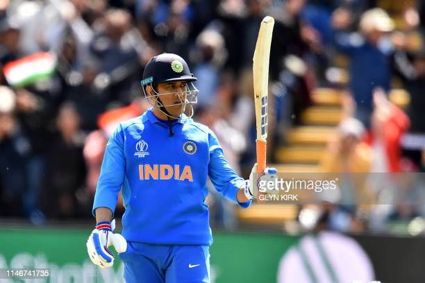India's Mahendra Singh Dhoni celebrates as he makes his century during the 2019 Cricket World Cup warm up match between Bangladesh v India at Sophia...