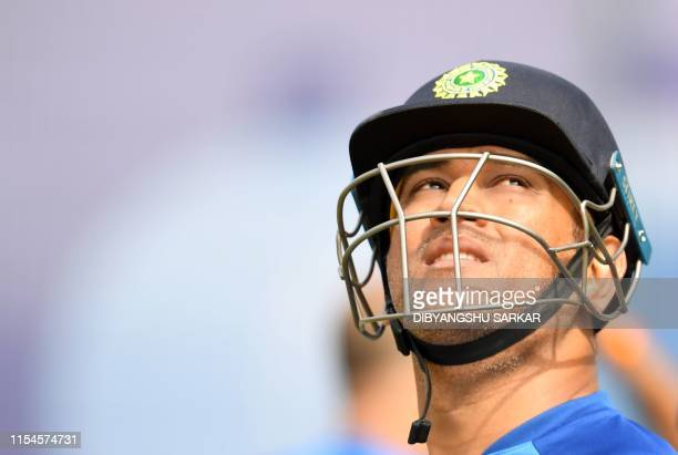 TOPSHOT India's Mahendra Singh Dhoni looks on after a session in the nets as he takes part in a training session at Old Trafford in Manchester...