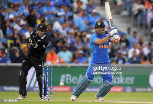 India's Mahendra Singh Dhoni plays a shot during the 2019 Cricket World Cup first semifinal between New Zealand and India at Old Trafford in...