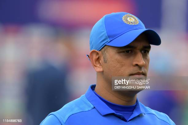 India's Mahendra Singh Dhoni reacts at the end of play during the 2019 Cricket World Cup first semifinal between New Zealand and India at Old...