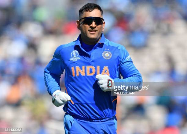 India's Mahendra Singh Dhoni runs on the pitch during the 2019 Cricket World Cup group stage match between India and Afghanistan at the Rose Bowl in...