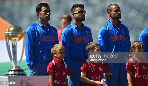 India's Mahendra Singh Dhoni Virat Kohli and Shikhar Dhawan line up for the national anthem prior to the start of the 2015 Cricket World Cup Pool B...