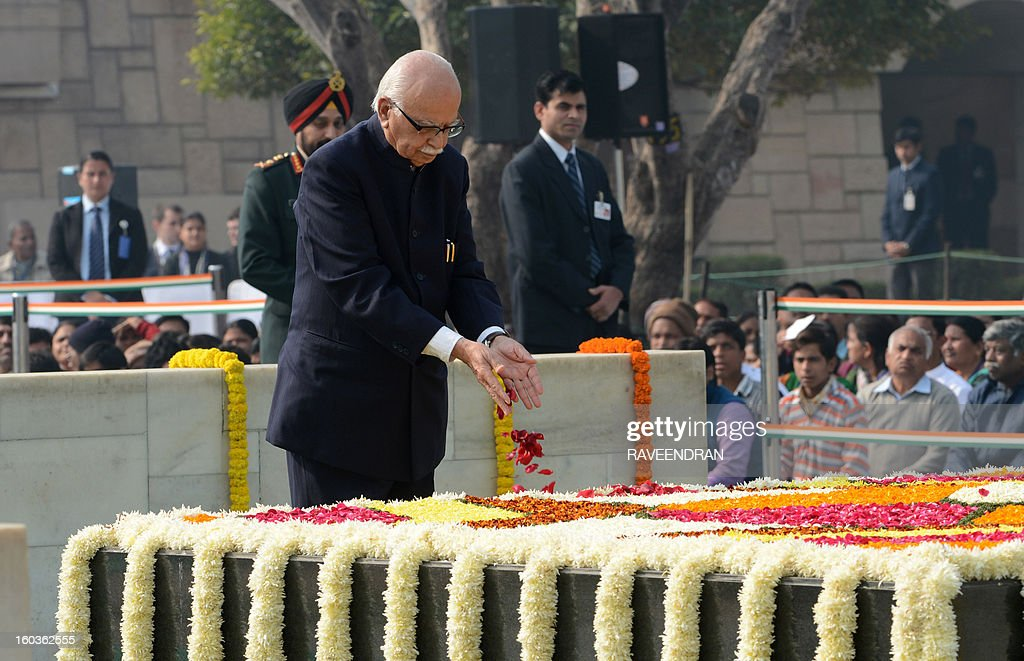 India's main opposition Bharatiya Janata Party (BJP) Senior leader Lal Krishna Advani pays homage at Rajghat, the memorial of India's founding father Mahatma Gandhi, on Martyrs Day in New Delhi on January 30, 2013, the 65th anniversary of Gandhi's assassination. Mahatma Gandhi was on the way to a prayer meeting in the Indian capital when he was shot three times in the chest and head on January 30, 1948.