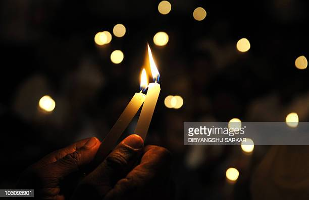 India's main opposition Bharatiya Janata Party supporters participate in a candle light vigil to commemorate Vijay Diwas the anniversary of the end...