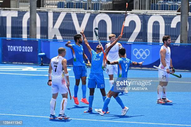 India's Mandeep Singh celebrates after scoring against Belgium during their men's semi-final match of the Tokyo 2020 Olympic Games field hockey...