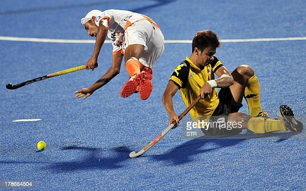 India's Mandeep Singh collides with Malaysia's Izad Hakimi during their semifinal match at the Asia Cup field hockey 2013 tournament in Ipoh oustide...