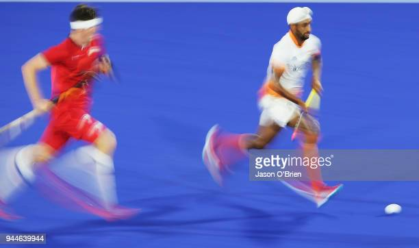 India's Mandeep Singh runs with the ball against England during Hockey on day seven of the Gold Coast 2018 Commonwealth Games at Gold Coast Hockey...