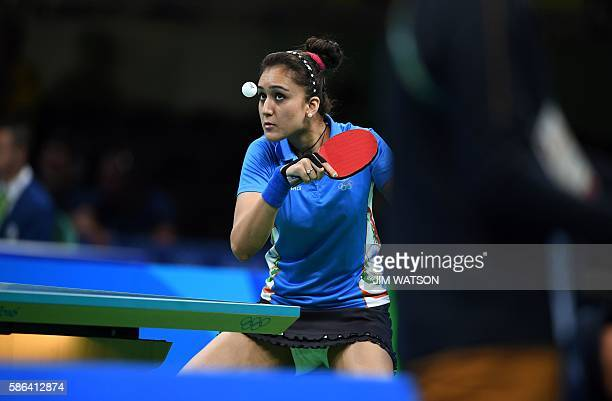 India's Manika Batra hits a shot in her women's singles qualification round table tennis match at the Riocentro venue during the Rio 2016 Olympic...