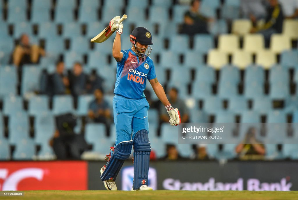 India's Manish Pandey celebrates his half century during the second T20I cricket match between South Africa and India at Super Sport Park Stadium in Pretoria on February 21, 2018. / AFP PHOTO / Christiaan Kotze