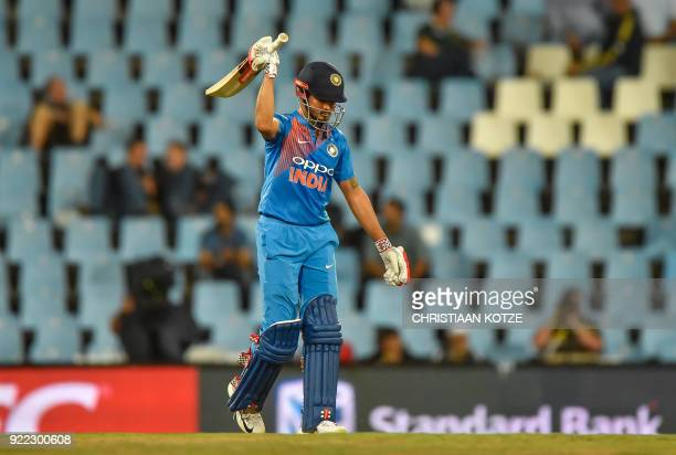 India's Manish Pandey celebrates his half century during the second T20I cricket match between South Africa and India at Super Sport Park Stadium in...
