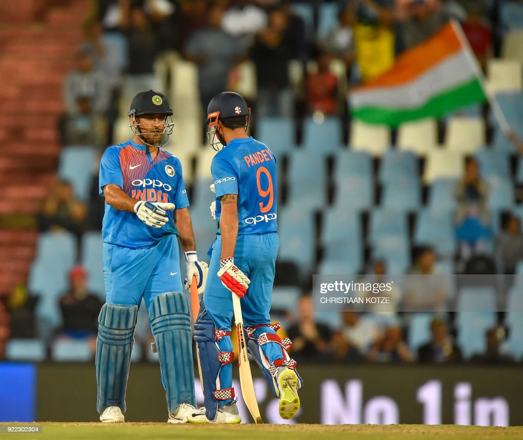 India's Manish Pandey (L) celebrates his half century with India's Dhoni during the second T20I cricket match between South Africa and India at Super Sport Park Stadium in Pretoria on February 21, 2018. / AFP PHOTO / Christiaan Kotze