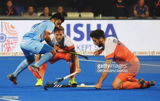 India's Manpreet Singh fights for the ball with Netherland's Valentin Verga during the field hockey quarterfinal match between India and the...