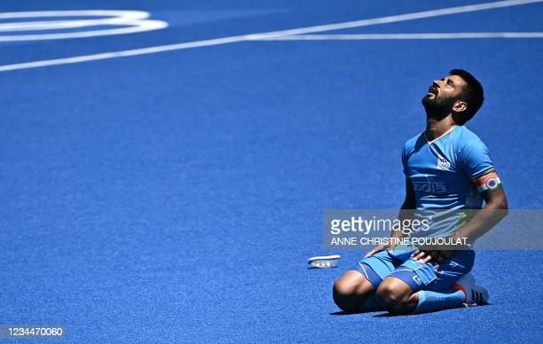 India's Manpreet Singh reacts after winning the men's bronze medal match of the Tokyo 2020 Olympic Games field hockey competition by defeating...