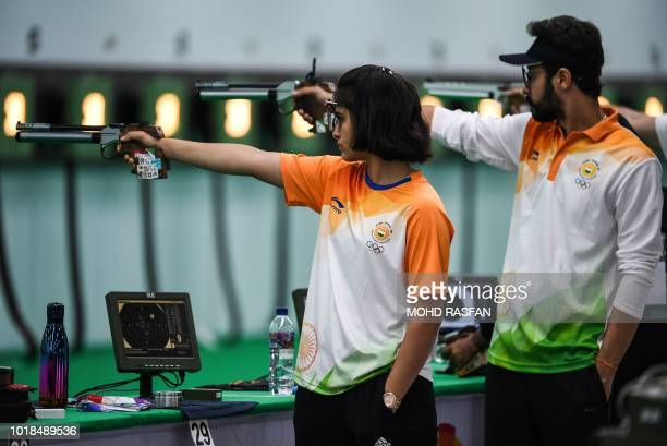 India's Manu Bhaker and Abhishek Verma attend a practise session for the mixed team 10m air pistol ahead of the 2018 Asian Games in Palembang on...