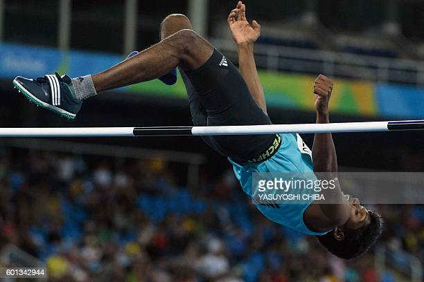 India's Mariyappan Thangavelu jumps in the men's final high jump T42 during the Paralympic Games at the Olympic Stadium in Rio de Janeiro on...